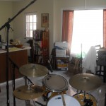 Drummer's side view of snare (Sennheiser e609), tom (Shure SM57), and overhead (Rode NT-1) mics