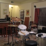 Drummer's view showing overhead ribbon mic, snare mic, and room mics (aimed at walls, away from the kit)